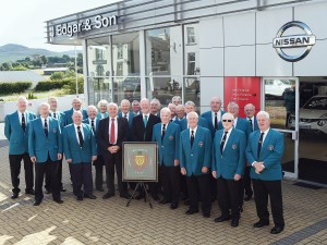 Whitehaven Male Voice Choir receive a three year sponsorship from J Edgar & Son at Rowrah. pic MIKE McKENZIE 12th Aug 2015 EDGAR'S IN HARMONY WITH CHOIR: Terry Edgar, third left on the front row with members of the Whitehaven Male Voice Choir after announcing a three year sponsorship from the J Edgar & Son franchice at Rowrah. pic Mike McKenzie50079451W000.JPG