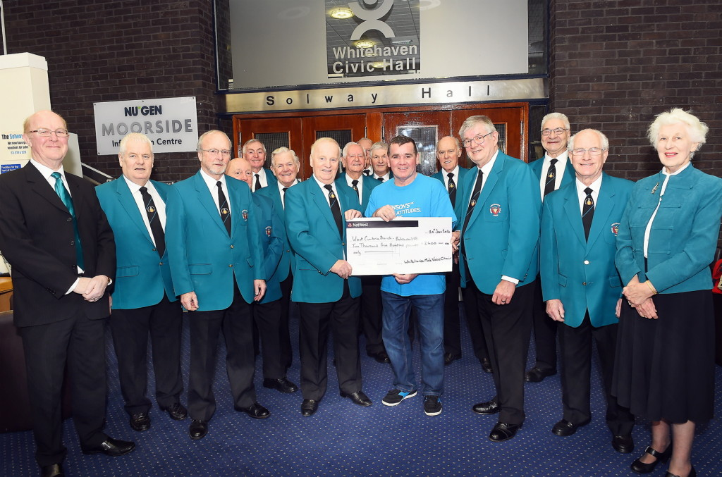 In January the choir presented a cheque for £2600 to John Kane of the west Cumbria branch of Parkinson's UK. The money was from proceeds of the choir's Chrismas concert and carol singing in local supermarkets.